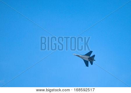 Russian newest fighter jet in the blue sky shows higher