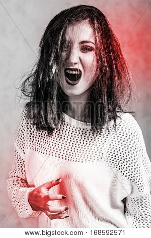 Screaming Young Woman In A White Sweater
