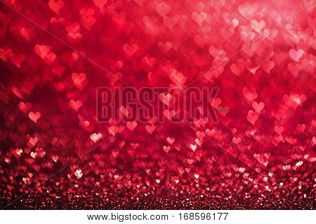Red glowing bokeh hearts background for Valentines day