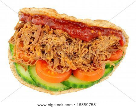 Shredded beef sandwich in a folded wholemeal flatbread isolated on a white background