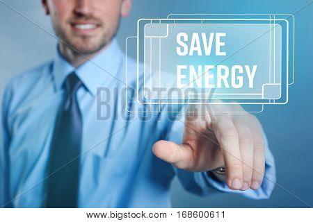 Man pushing SAVE ENERGY button on virtual screen