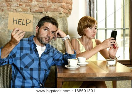 young American couple at coffee shop with internet and mobile phone addict woman ignoring bored sad and frustrated man boyfriend or husband in relationship problem asking for help poster