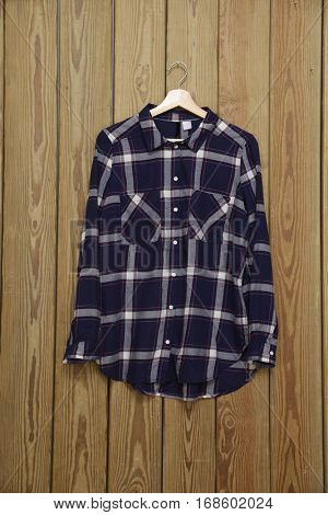 Blue cotton shirts sleeved plaid -wooden background