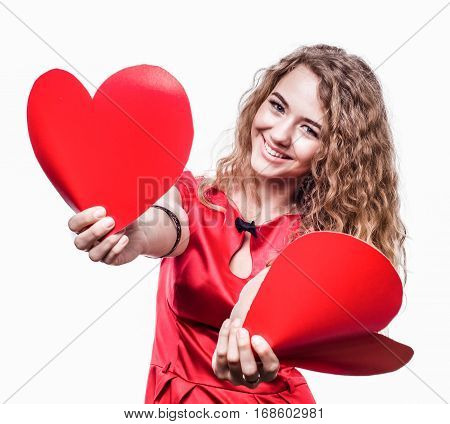 Girl holding two hearts and winks. valentine's day