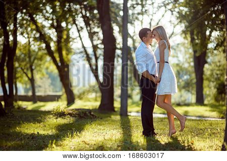 Romantic young couple stay together in park