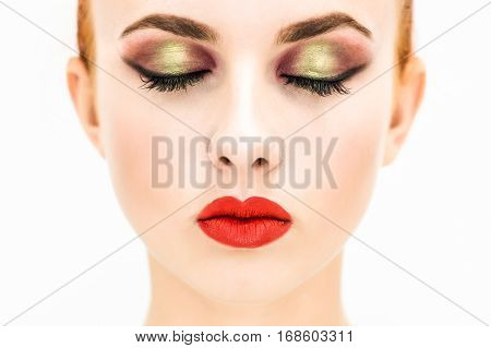 Close-up. Portrait of a woman with red lips and closed eyes on a light background