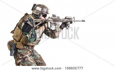 United states Marine Corps special operations command Marsoc raider with weapon aiming a gun. Studio shot of Marine Special Operator white background