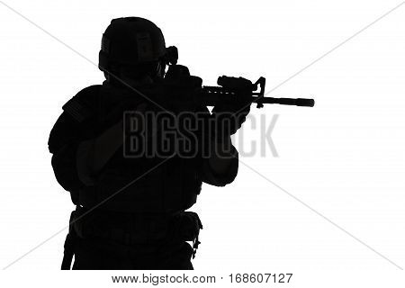 United states Marine Corps special operations command Marsoc raider with weapon aiming a gun. Silhouette of Marine Special Operator white background