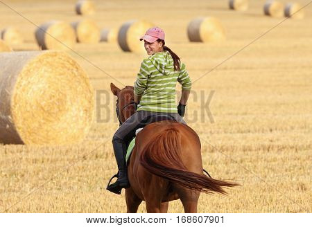 Woman on Horseback Riding in a Landscape