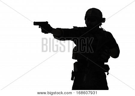 United states Marine Corps special operations command Marsoc raider with weapon aiming pistol. Silhouette of Marine Special Operator white background