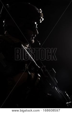 United states Marine Corps special operations command Marsoc raider. Contour backlit studio shot of Marine Special Operator black background