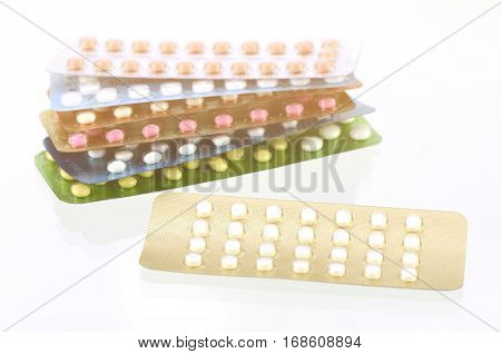 Mini-pills With Oral Contraceptive Pills Background In Warm Light Tone.