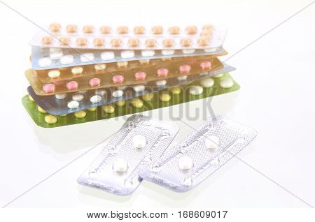 Emergency Pills With Oral Contraceptive Pills Background In Warm Light Tone.