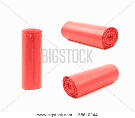 Red plastic polyethylene trash bag roll isolated over the white background, set of three different foreshortenings