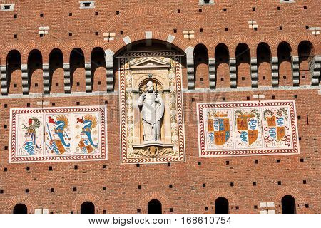 Detail of the tower of Filarete (clock tower) with the coat of arms of the Visconti family. Sforza Castle XV century (Castello Sforzesco) Milan (Milano) Lombardy Italy