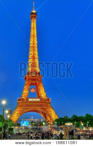 Paris, France - July 05, 2016 : Beautiful Light Show Of Flashing Lights On The Eiffel Bache In Paris