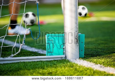 Soccer football strategy planning board. Coaching soccer. Coach having training with soccer football team. Soccer education. Sports soccer abstract background