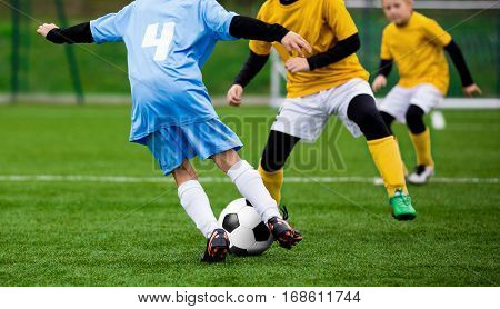 Football Soccer Match for Children. Kids Playing Soccer Game Tournament. Boys Running and Kicking Football on the Sports Grass Field