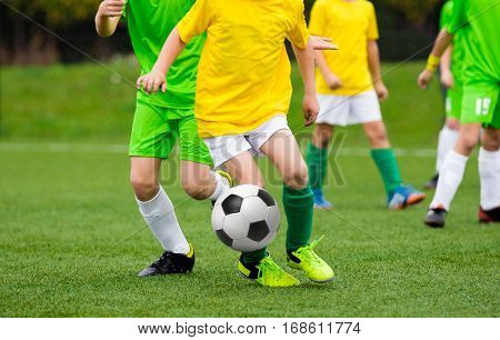 Running Football Soccer Players with Ball. Footballers Kicking Football Match on the Pitch. Young Teen Soccer Game. Youth Sport Background