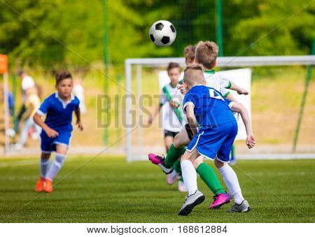 Football soccer tournament match for children. Boys training football on the pitch. Kids kicking soccer game