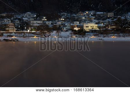 Fujikawaguchiko Town at night with Lake kawaguchi, Japan