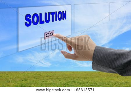 asian business man hand push on Solution button on touch screen panel for business concept