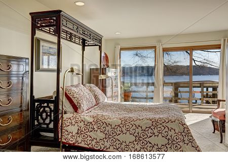 Waterfront Home Bedroom Boasts King Size Canopy Bed