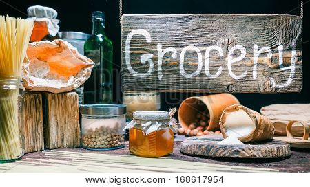 Grocery shop counter. Only natural goods and package materials. Wooden sign