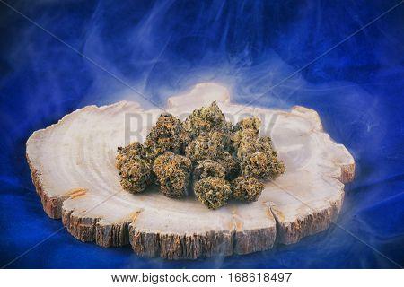 Detail of cannabis buds (deep purple strain) with smoke - medical marijuana dispensary concept