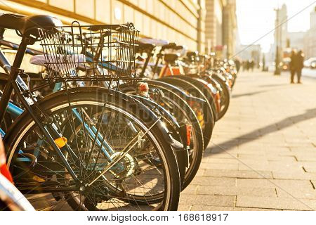 Many bikes in a row on the street in Munich, Bavaria, Germany, Europe. Bicycle parking. Environmentally friendly and healthy means of transportation around the city.