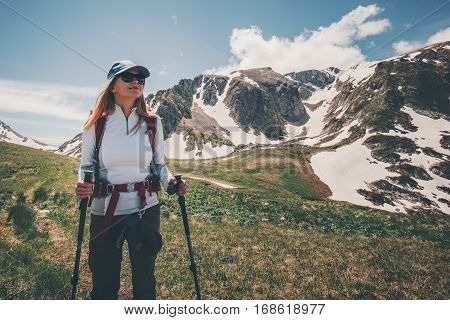 Woman backpacker traveling hiking in mountains Travel Lifestyle success concept adventure active summer vacations outdoor mountaineering sport
