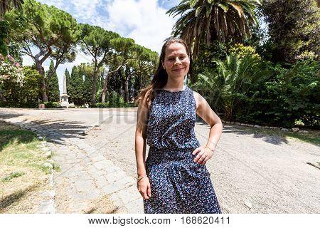 Girl In The Parco Della Rimembranza Of Grosseto In The Italian Region Tuscany