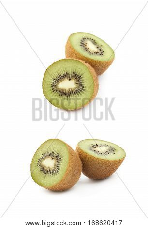 Sliced ripe kiwi fruits composition isolated over the white background, set of two different foreshortenings