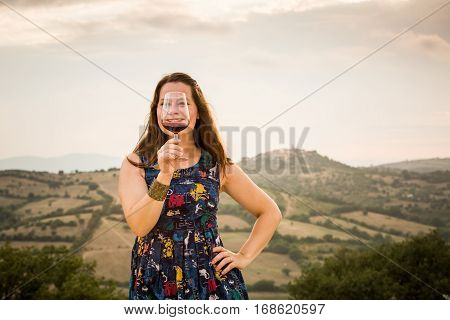 Girl In Blue Dress With A Glass Of Wine In Tuscany, Italy