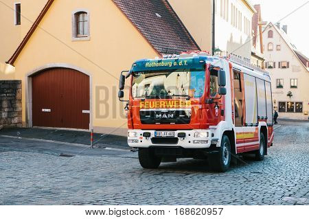 Rothenburg ob der Tauber, Germany, December 30, 2016: Fire truck rides after extinguishing a fire in the historic town of Rothenburg ob der Tauber in Germany in Europe