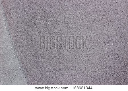 grey fabric texture with seam stitch on the side