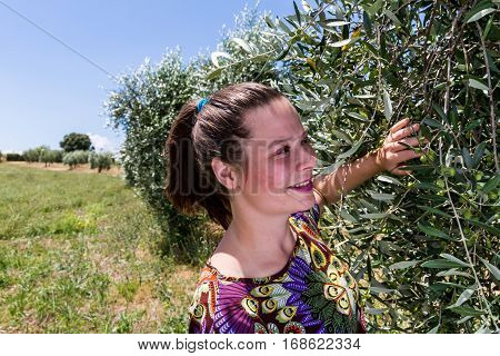 View of a girl standing in the Tuscan fields in summer 2016 poster
