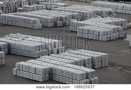 Metal aluminum and titanium in ingots in the warehouse products
