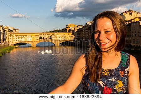 Girl In Front Of The Ponte Vecchio In Florence, Italy In Summer 2016
