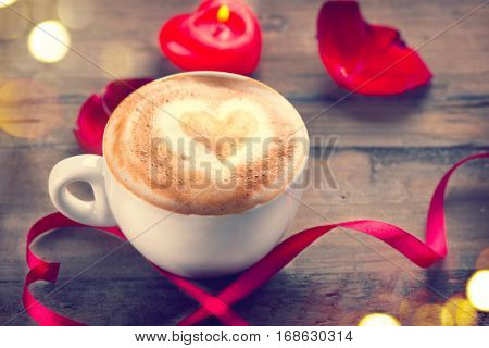 Valentine's Day Coffee with heart on foam. Heart drawing on latte art coffee. Love concept. Romantic Valentine background