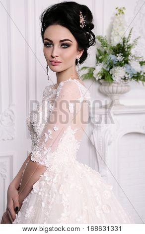 Gorgeous Bride With Dark Hair In Luxuious Wedding Dress
