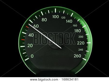 Speedometer of a car showing 50, glowing green