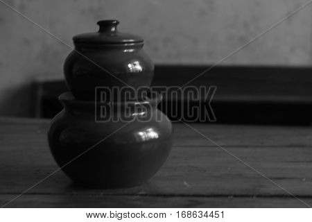 Clay pots for cooking in black and white style