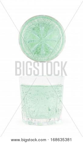 Rocks old fashioned glass filled with the carbonated green lemonade water isolated over the white background, set of two different foreshortenings