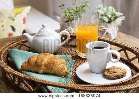 Breakfast Tray, Lifestyle / Tray with coffee, croissant, orange juice and cookie