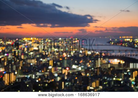 Blurred bokeh lights Osaka city downtown with beautiful sunset sky abstact background