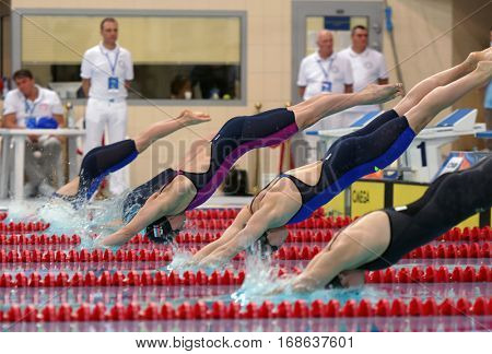 ST. PETERSBURG, RUSSIA - DECEMBER 17, 2016: Start of women 50 m butterfly swimming competition during X Vladimir Salnikov Cup. Athletes from 6 countries participated in the competitions