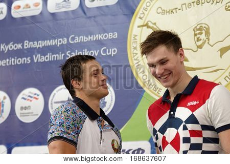 ST. PETERSBURG, RUSSIA - DECEMBER 16, 2016: Winners of X Salnikov Cup in 100 m freestyle swimming Alexander Kliukin of Russia (right) and Artyom Machekin of Belarus