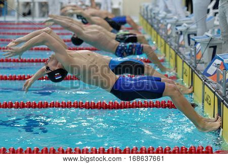 ST. PETERSBURG, RUSSIA - DECEMBER 17, 2016: Men on the start of 50 m backstroke swimming during X Vladimir Salnikov Cup. Athletes from 6 countries participated in the competitions