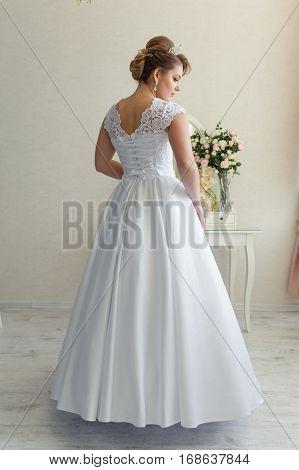 Bride in wedding dress before wedding ceremony. Morning bride